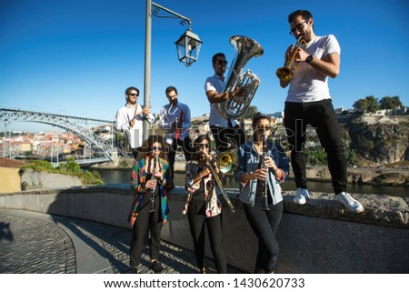 Group of Jazz musicians with wind instruments playing on the street. #1430620733