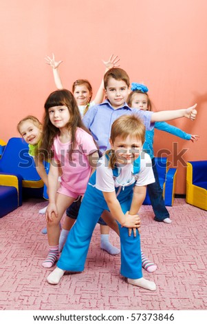 Group of joyful preschool kids