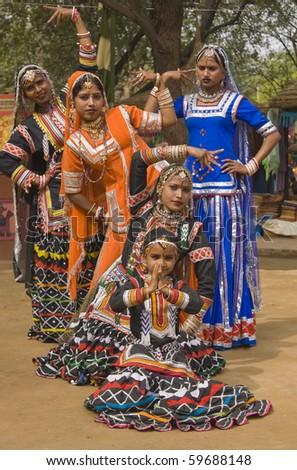 Group of Kalbelia tribal dancers performing at the annual Sarujkund Fair near Delhi, India - stock photo