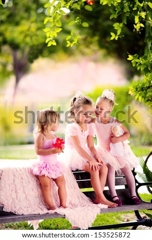 group of kid girl in dance costumes have a fun outdoor