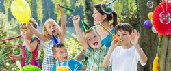 Group of kids celebrating their friend's birthday party