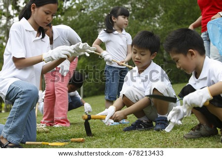 Group of kids cleaning the park