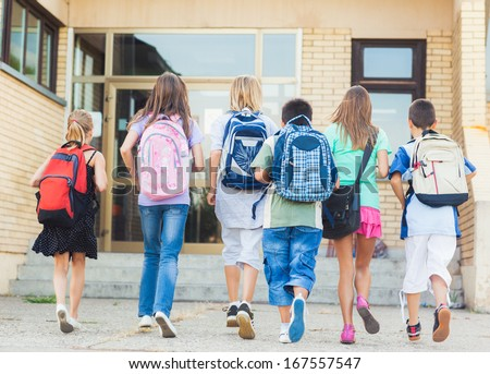Group of kids going to school together.