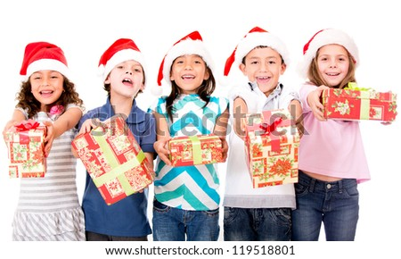 Group of kids holding Christmas presents - isolated over a white background