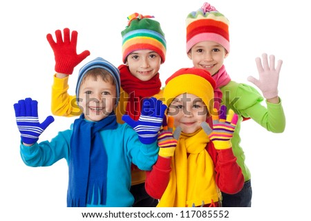 Group of kids in bright winter clothes, isolated on white