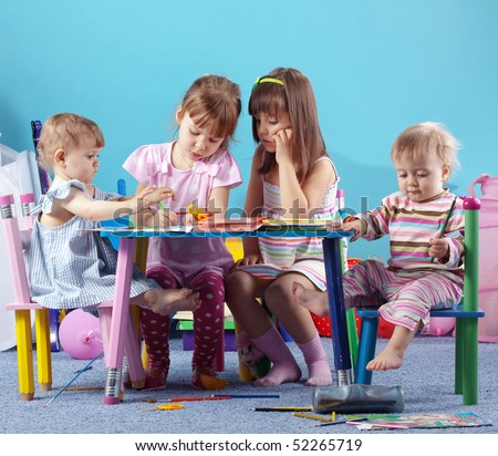 Group of kids playing in the kindergarten