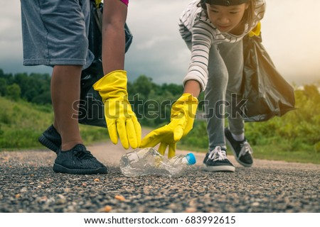 Group of kids volunteer help garbage collection charity environment. #683992615