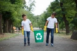Group of kids volunteer help garbage collection charity environment, selective soft focus. Team work.