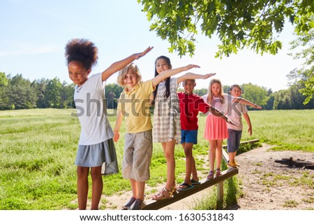 Group of kids while balancing on a beam for skill Сток-фото ©