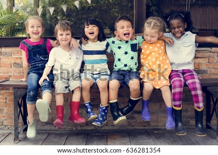 Group of kindergarten kids friends arm around sitting and smiling fun #636281354