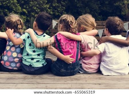 Group of kindergarten kids friends arm around sitting together Stock photo ©