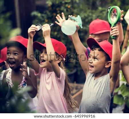 Group of kindergarten kids learning gardening outdoors #645996916