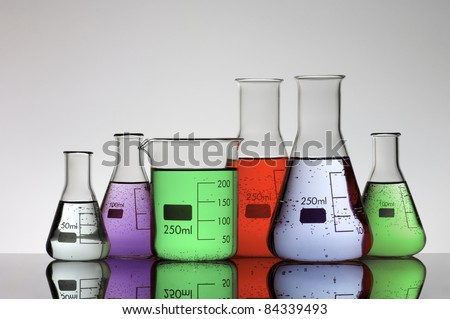 group of laboratory flasks brightly colored liquid