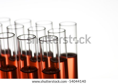 group of laboratory test tubes with red liquid inside