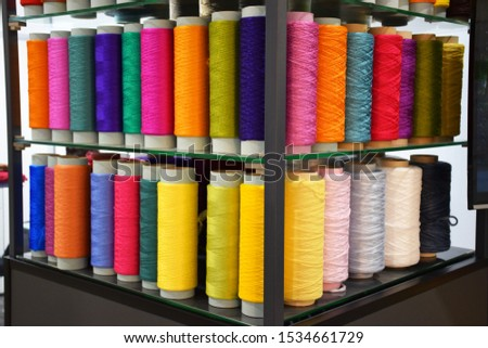 Group of Large colorful polypropylene threads set in rainbow mood. Multicolored bobbin thread. Polypropylene multifilament yarns. Set of sewing thread coils, miscellaneous colours. #1534661729