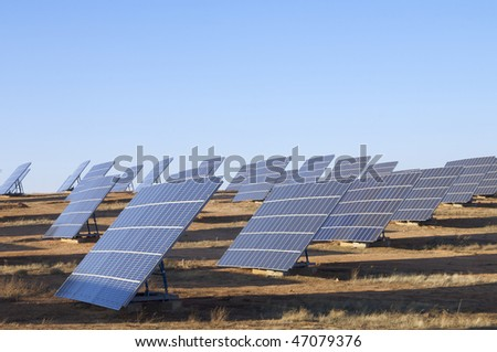 group of large photovoltaic panels with clear blue sky