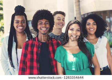 Group of latin american and african and hispanic young adults outdoor in the city