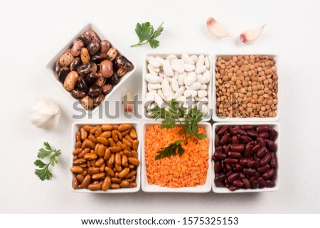 Group of legumes, beans and lentils as food ingredients on white background.