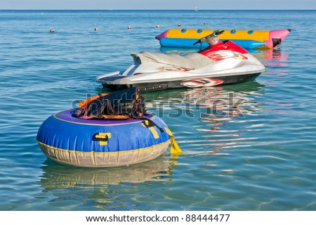 Group of life jackets on life buoy jet ski and banana boat in the