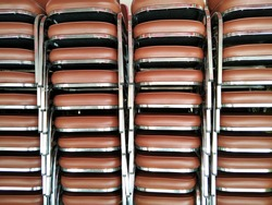 Group of light brown metal chair overlay in row