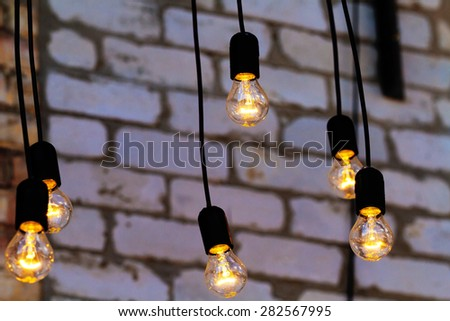 Group of light bulbs hanging from the ceiling