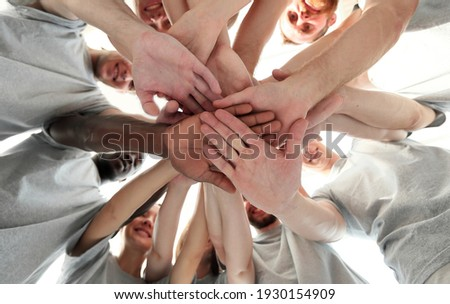 group of like-minded people cupping their palms together Stock photo ©