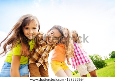 Group of little 6 and 7 years old smiling kids smiling standing outside in the park #159883664