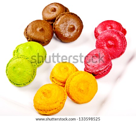 Group of macaroons different colours on white plate