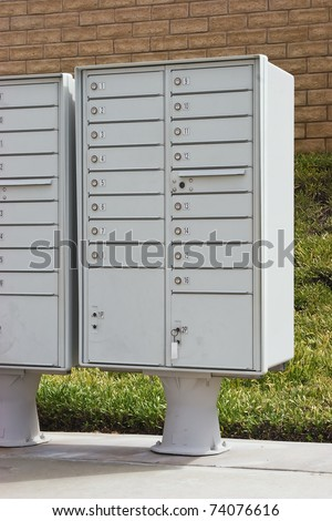 Group of mailboxes are in an arrangement in a residential neighborhood.