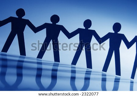 Group of male paper chain representing teamwork. - stock photo