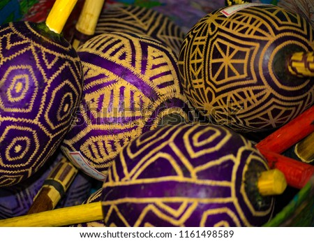 Group of maracas, african originated percussive musical instrument with ritualistic symbols painted.