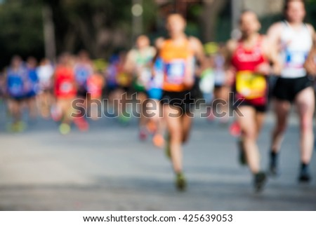 group of marathon runners, abstract blurry picture #425639053