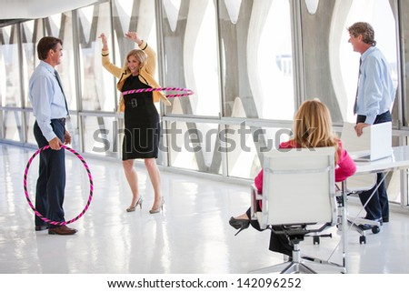 Group of Mature Adults taking a play Break in a modern office to get ideas flowing