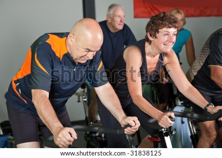 Group of mature people in a spinning class