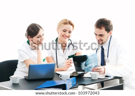 Group of medical workers discussing in office