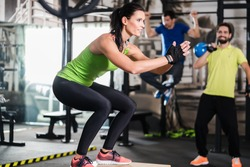 Group of men and woman in functional training gym doing fitness exercise
