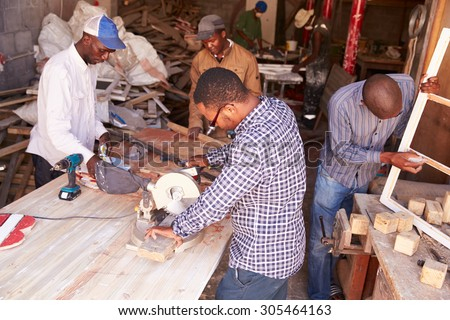 Group of men at work in a carpentry workshop, South Africa