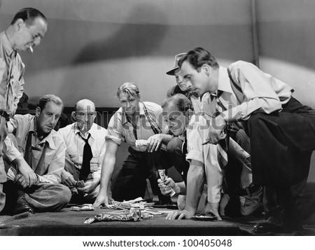Group of men gambling