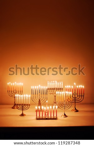 Group of menorahs lit for Hanukkah