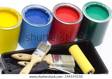 Group of metal tin cans with brush and painter roller