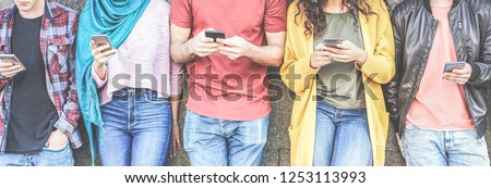 Group of millennial friends watching social stories on smart mobile phones - People addiction to new technology trends - Concept of youth, texting, social and friendship - Main focus on center hands