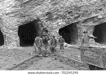 group of miners working at...