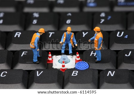 Group of miniature computer technicians repairing a missing key on a laptop keyboard. Computer repair concept. - stock photo