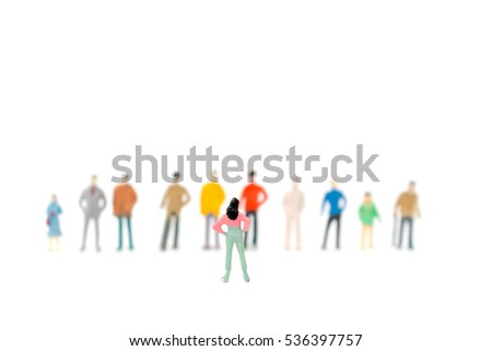 Group of miniature people standing on white background