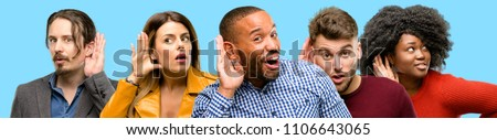 Group of mixed people, women and men holding hand near ear trying to listen to interesting news expressing communication concept and gossip