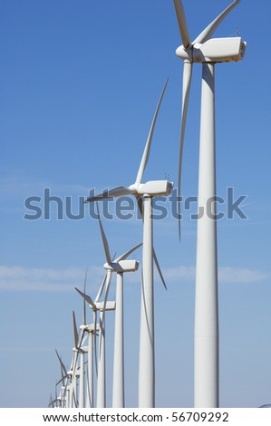 group of modern windmills with blue sky