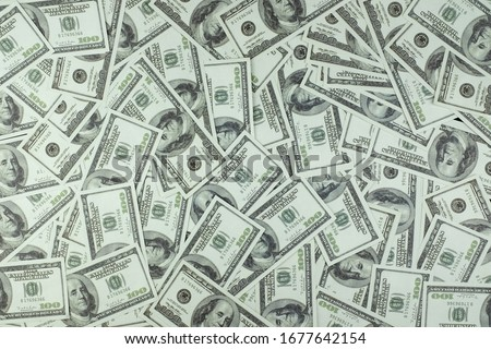 Group of money stack of 100 US dollars banknotes a lot of the background texture top view