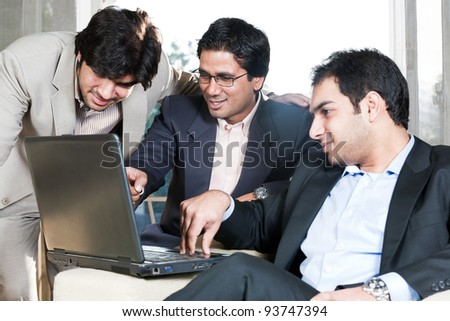 group of multi ethnic businessmen, indian businessman in a meeting with his colleagues