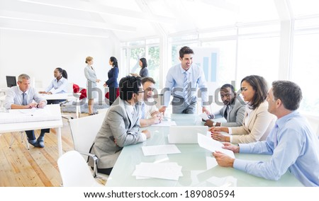 Group of Multi Ethnic Corporate People Interacting with the Speaker