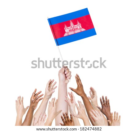 Group Of Multi-Ethnic People Reaching For And Holding The Flag Of Cambodia